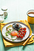 Vegeterian breakfast with potato cake, fried egg, grilled mushrooms and tomatoes