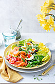 Spring salad with soft boiled eggs, beans, smoked salmon and cress