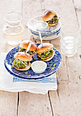 Broccoli sesame sliders with sprouts and chive dip