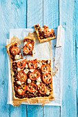 Minced meat tart with tomatoes and pine nuts