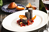 Chicken mousse rolled in poppy seeds