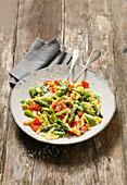 Vegetarian garlic spaetzle with green asparagus