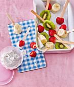 Fruit lollipops with yogurt dip