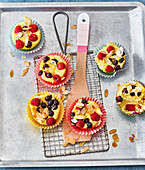 Quark vanilla muffins with fresh berries and flaked almonds