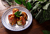 Chicken skewers with bacon and zucchini