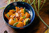 Roasted Peaches with almonds and mint
