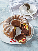 Cocoa fancy cake with custard balls