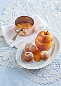 Baked apples with orange marmelade and doughnuts