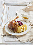 Honey duck with potato dumplings and red cabbage