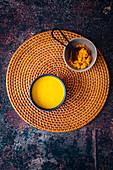 Turmeric Golden Milk on woven grass placemat