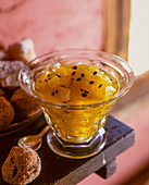 Mango and passion fruit preserve in a glass bowl