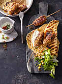 Turkish chicken kebabs with mint yoghurt and unleavened bread