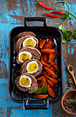Meat roulade with Scottish eggs