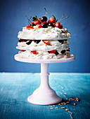 Amaretto meringue cake with strawberries and cherries