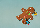 Boy and girl assembling gingerbread man