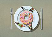 People indulging in large sprinkle donut on plate