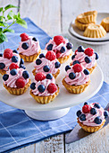 Nut tartlets with raspberry cream and blueberries