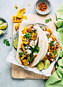 Colourful tacos with vegetables and feta cheese