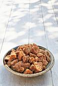 A bowl of jaggery (raw sugar)