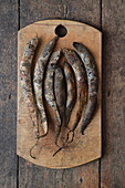 Dried bean pods on a rustic wooden board