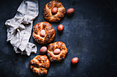 Italian Easter nests made from yeast dough with boiled eggs