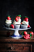 Chocolate cupcake with mascarpone frosting and strawberry