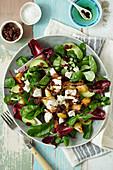 Warm crispy potato, feta and raisin salad