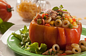 A stuffed beefsteak tomato filled with tuna, pasta and vegetables