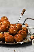 Fried goat cheese balls with pistachios and truffle honey