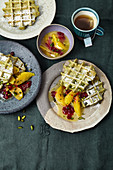 Poppy seed and pistachio waffles with orange and cranberry compote