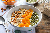 Muesli with fried apricots, almonds and pistachios