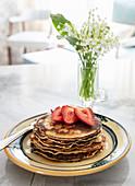 Whole wheat sourdough pancakes with fresh strawberries