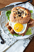Bialys with Goat Cheese and Onions with an egg ans sausage