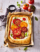 Puff pastry cake with ricotta and tomatoes