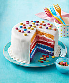 Rainbow cake with M and M bonbons