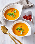 Pumpkin creamy soup with coconut milk and chili