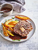 Rib eye steak with baked batads and pepper sauce