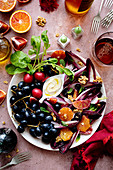 Fruits, red chicory radish and walnuts with hummus