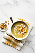 Celeriac soup with apple and walnuts