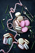 Assorted delectable macarons placed on pink table