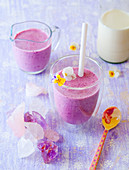 Blueberry smoothies with edible flowers