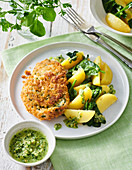 Turkey schnitzels with potatoes and chive-almond pesto