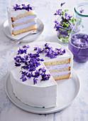 White cake (gateau) with violets