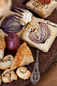 Puff pastry slices with red onions