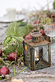 Vintage lantern, red onions, and cabbage heads as table decorations