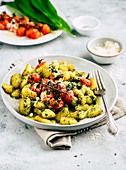 Delicate gnocchi in wild garlic butter with oven-roasted tomatoes