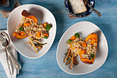 Pumpkin and sausage risotto, served on oven-baked pumpkin wedges