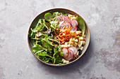 A salad with radishes, grated carrot, cheese and a nut mousse dressing