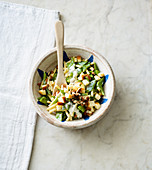 Pasta salad with beans, almonds and scamorza
