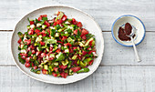 Turkish salad made with cucumber, tomato, pointed peppers and mint